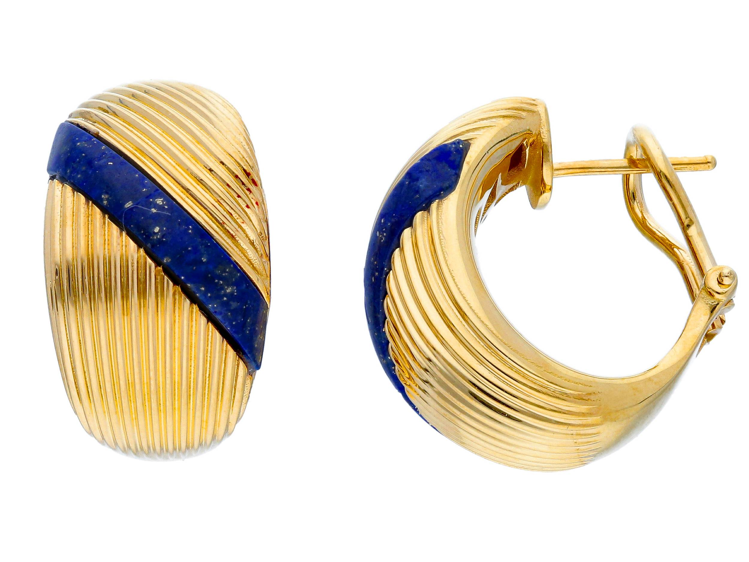 Beautiful 18ct Yellow Gold Stud/Clip Earrings with a blue stone.We have different colours of the stones available . Contact us for more information about the colours of enamel, gold and stones in our shop.